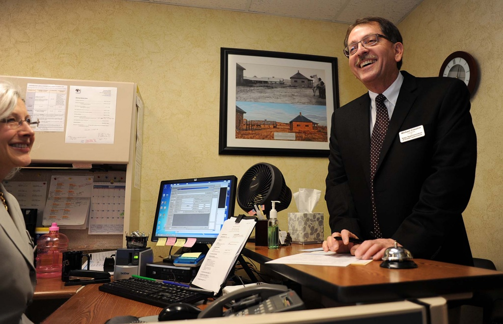 Mike Ceballos shares a laugh with an employee at the Secretary of State's office on Thursday, May 15, 2014 as he files as a candidate for Wyoming Superintendent of Public Instruction. Photo provided.