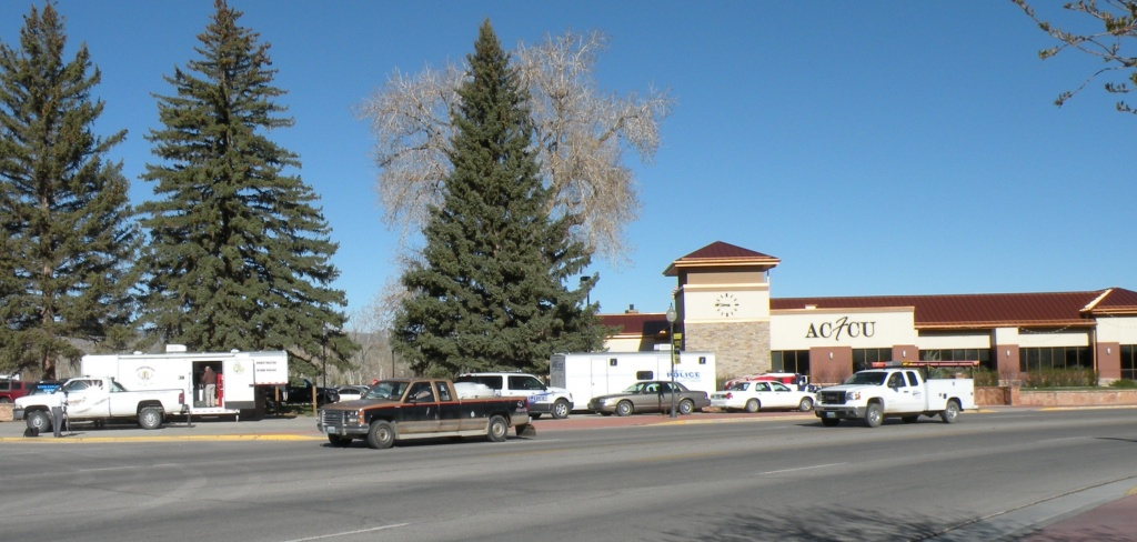 Law enforcement staged at the corner of 10th and Main Streets as settlement checks began to arrive last month.