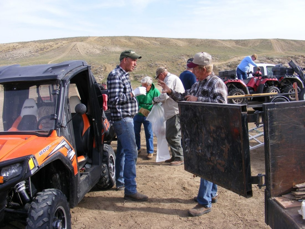 Fremont County ATV Association members Stan Rinker and Gary Fischer discuss cleanup logistics. (BLM Photo)
