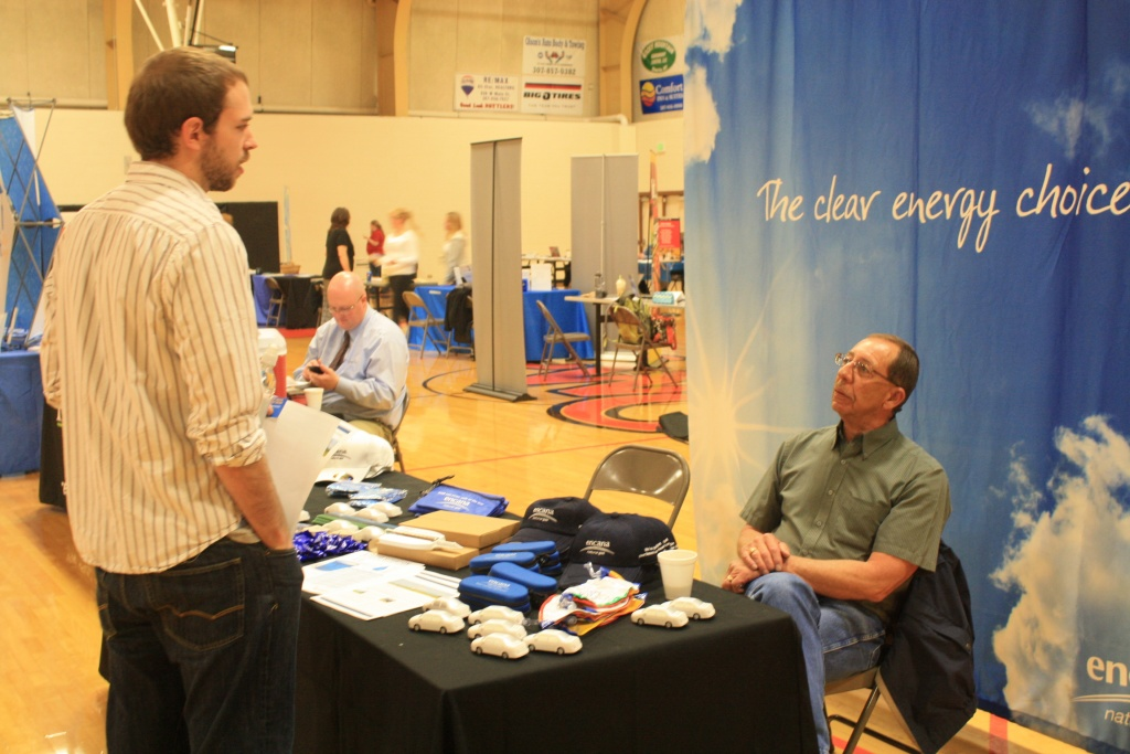 New graduate Jacob Myers of Lander talked with Paul Becker of Encana about job possibilities at today's Job Fair at CWC. (Ernie Over photo)