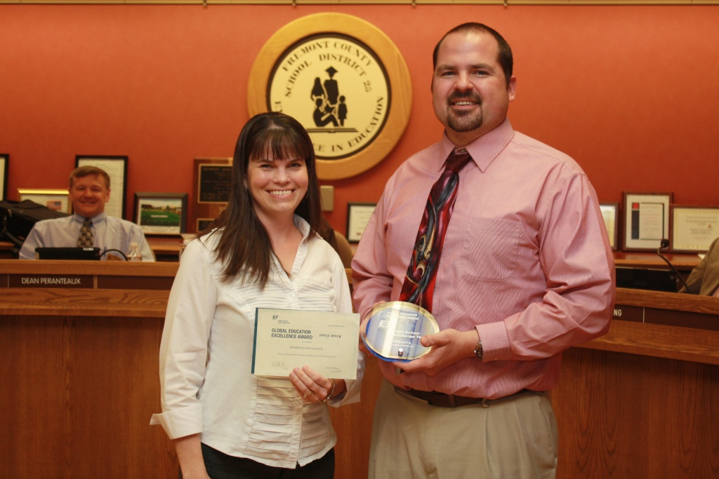 Stacey Peranteaux presented the EF Foundation for Student Exchange's Global Excellence Award to RHS Principal John Griffith Tuesday night. (Ernie Over photo)