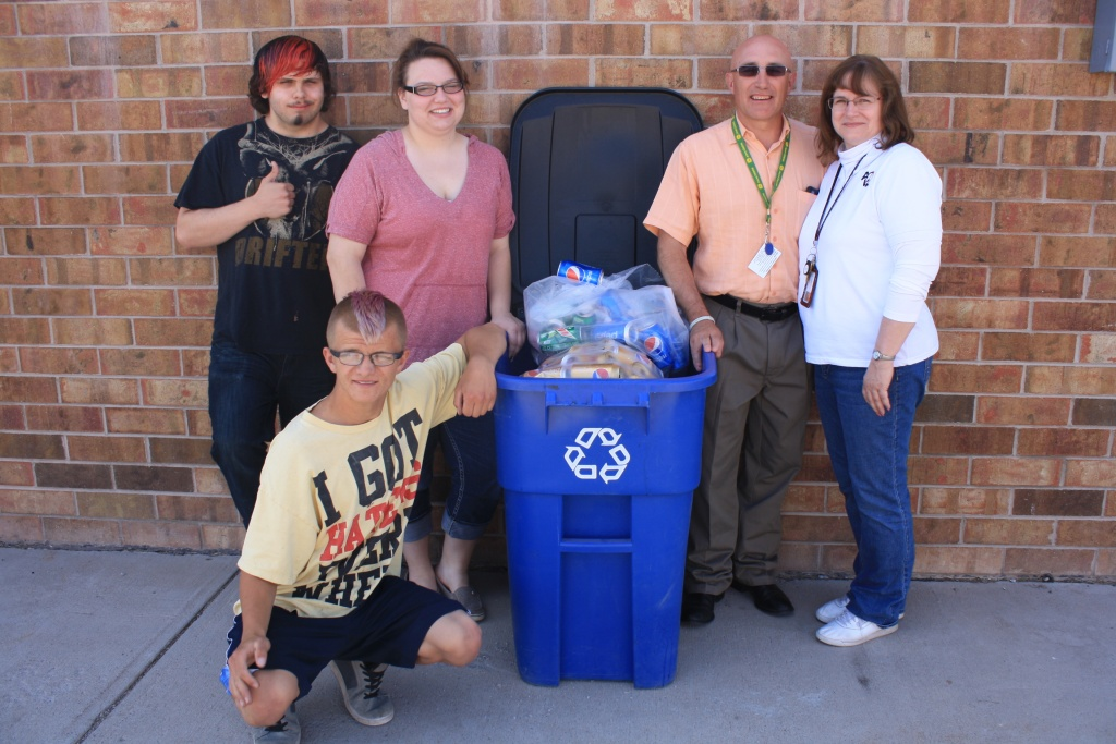 Students, from left, Devlin Austin, Jason Treadway (kneeling) and Erin Dykman with FCSD#25 Special Services Director Dallas Myers and instructor Pamela Pince with a recycling bin already filled with cans for next year's contest. (Ernie Over photo)
