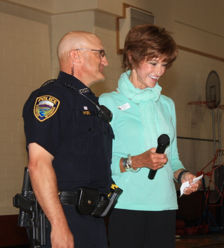 RMS School Resource Officer Cody Myers received the Craig and Susan Thomas Foundation's Leadership Award from Susan T homas during an assembly at the school Tuesday morning. (Ernie Over photo)