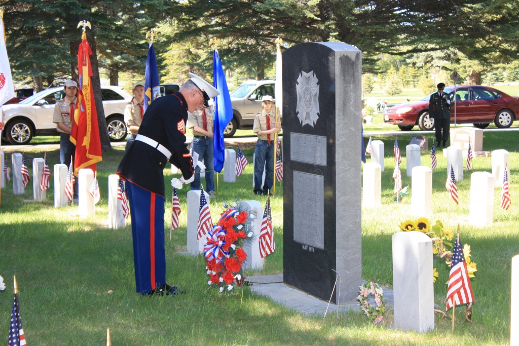 VFW Post 3628 Commander Gary Letchworth places a wreath at the Veteran's Memorial