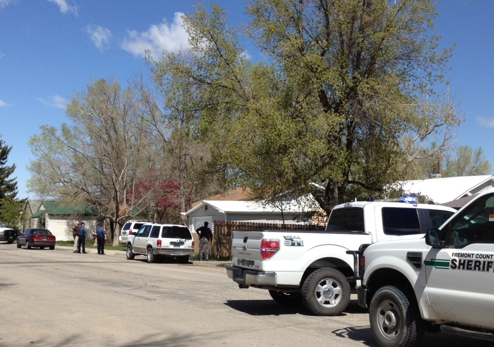 A total of 10 law enforcement vehicles from multiple agencies have arrived at the scene of a standoff in the 900 block of Washakie Street in Lander.  (Joshua Scheer photo)