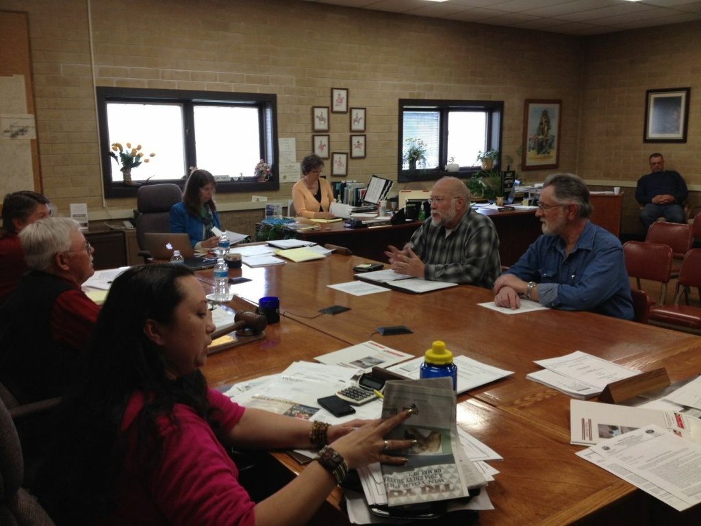 Fremont County Coroner Ed McAuslan and Deputy Mark Stratmoen meeting with the Fremont County Commission.