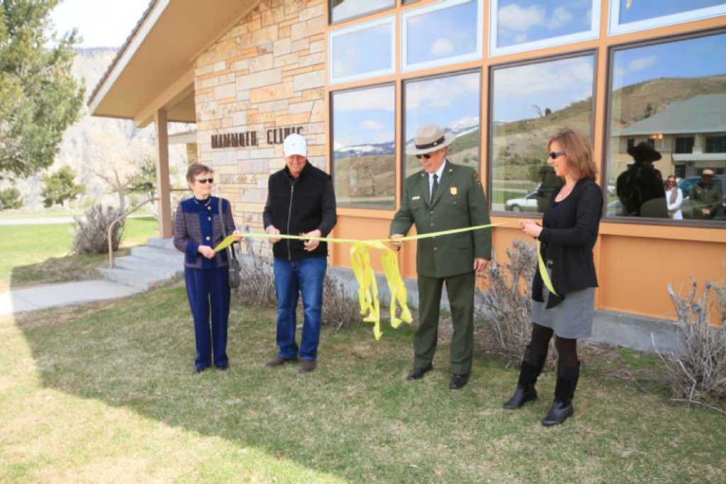 (Left to right) Yellowstone Park Foundation Board Chair Kay Yeager, Andersen Corporation CEO Jay Lund, Yellostone National Park Deputy Superintendent Steve Iobst and Deb Brown of Medcor celebrate the installation of energy efficient windows in the Mammoth Clinic building. NPS photo by Bob Greenburg.