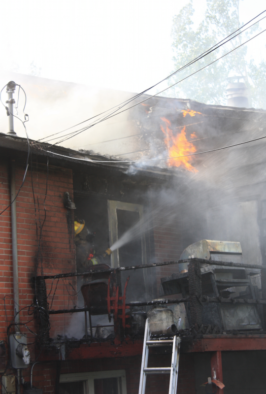 At the peak of the blaze, a firefighter attacked the outside of the house from inside the house. (Ernie Over photo)