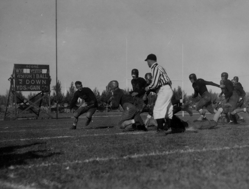 The University of Wyoming Cowboys football team on the gridiron in 1936. Corbett Field (today the site of the College of Business Building and Wyoming Union parking lot) was dedicated Oct. 14, 1922, and was home to the Cowboys until 1950, when War Memorial Stadium opened. Prior to Corbett Field, football games were played on Prexy's Pasture. A modest set of bleachers offered seating for the fans. (American Heritage Center)