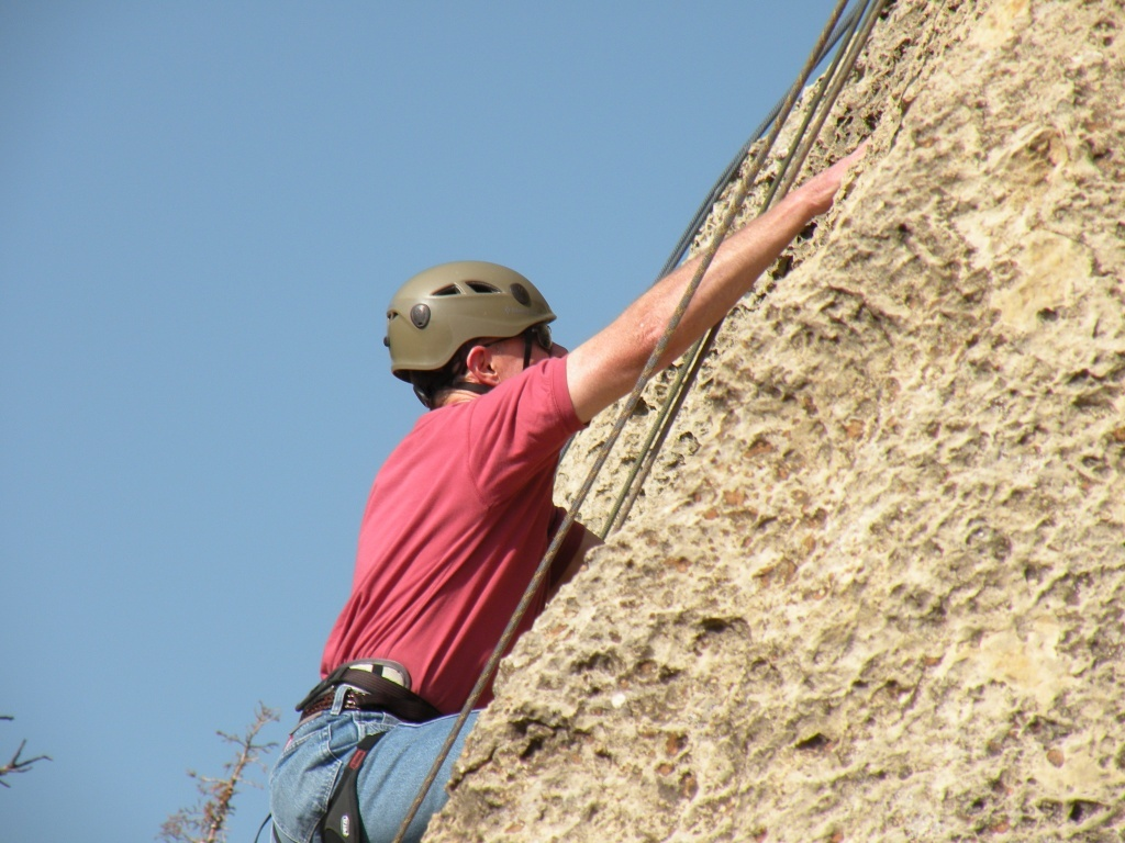 Superintendent Mike Bowman climbing with incoming freshmen last summer.