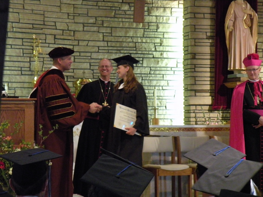 Deirdre Mary Dalimata shakes hands with President Dr. Kevin Roberts after walking the stage.