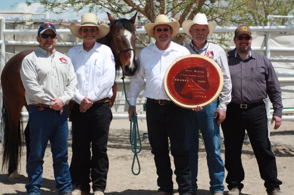 (From left to right) BLM Wind River/Bighorn Basin District Manager Steve Dondero, Wyoming Honor Farm Ranch Manager Joe Crofts, Fez, Honor Farm Training Supervisor Jeff Martin, BLM Wild Horse Specialist Scott Fluer and Honor Farm Warden Michael Pacheco. Martin was recognized at the adoption by the inmate trainers for his contributions to the wild horse training and adoption program. (BLM)