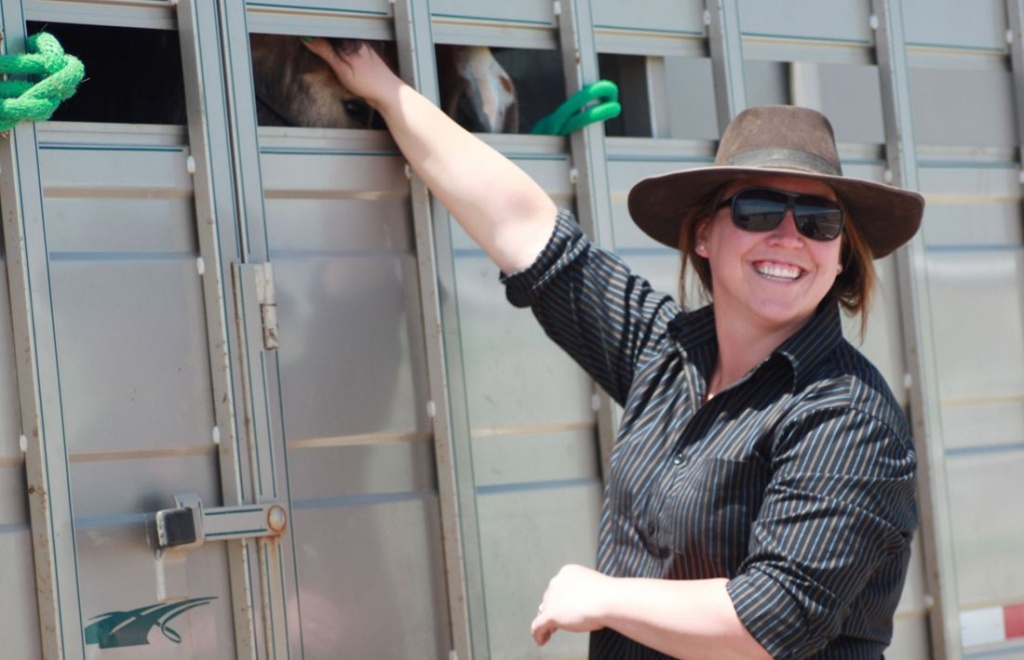 First time adopter Panther Lee has her gentled wild horses loaded up and ready to head home.