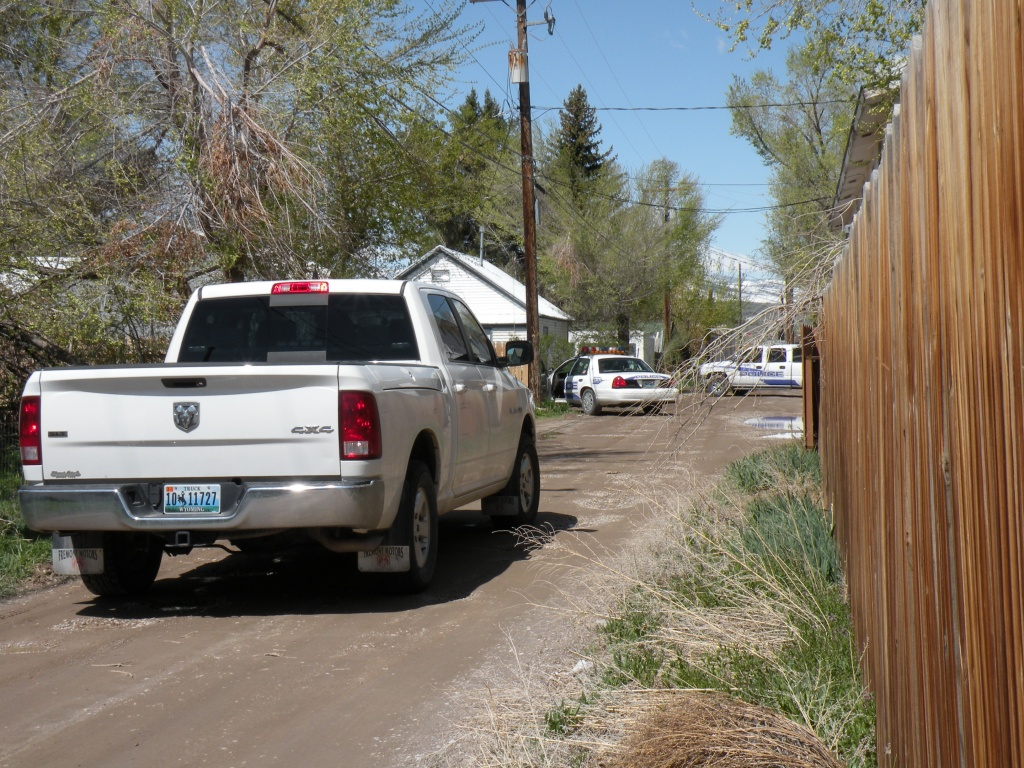 Law enforcement vehicles in the alley behind the residence where the alleged stolen vehicle was located.