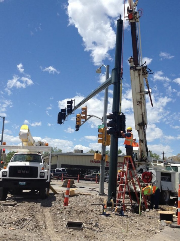 Workers put up the new traffic signal structures on South Federal at East Monroe today. The intersection will be closed for six weeks of reconstruction beginning this Saturday, May 31st. (Ernie Over photo)