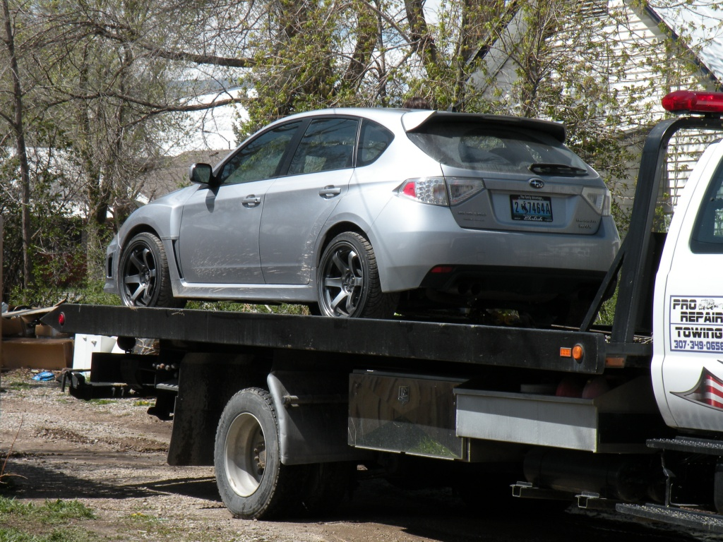 The alleged stolen vehicle atop a tow truck after police cleared the scene.