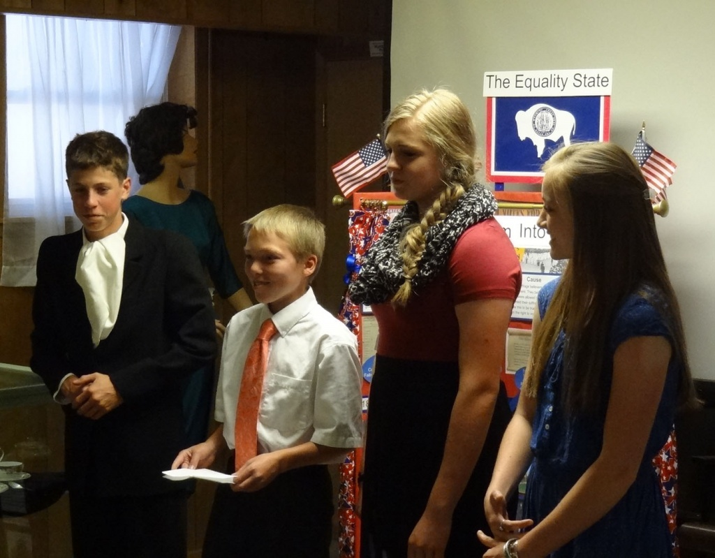 Noah Gans, James Whiting, Sydney Polson and Sadie Thatch present projects to the Fremont County Museums Board. Photo provided.
