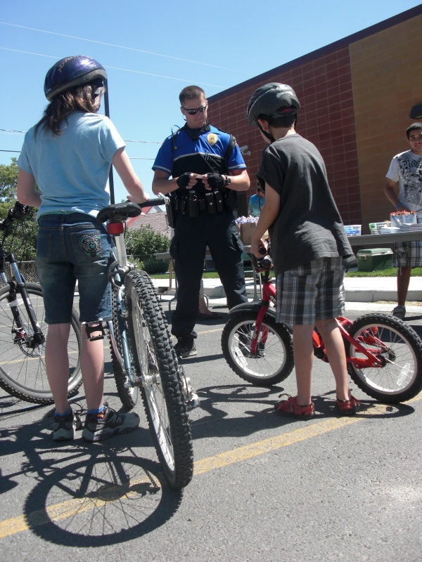 File photo of LPD Officer Colin Ryder speaking to young cyclists at a safety event.