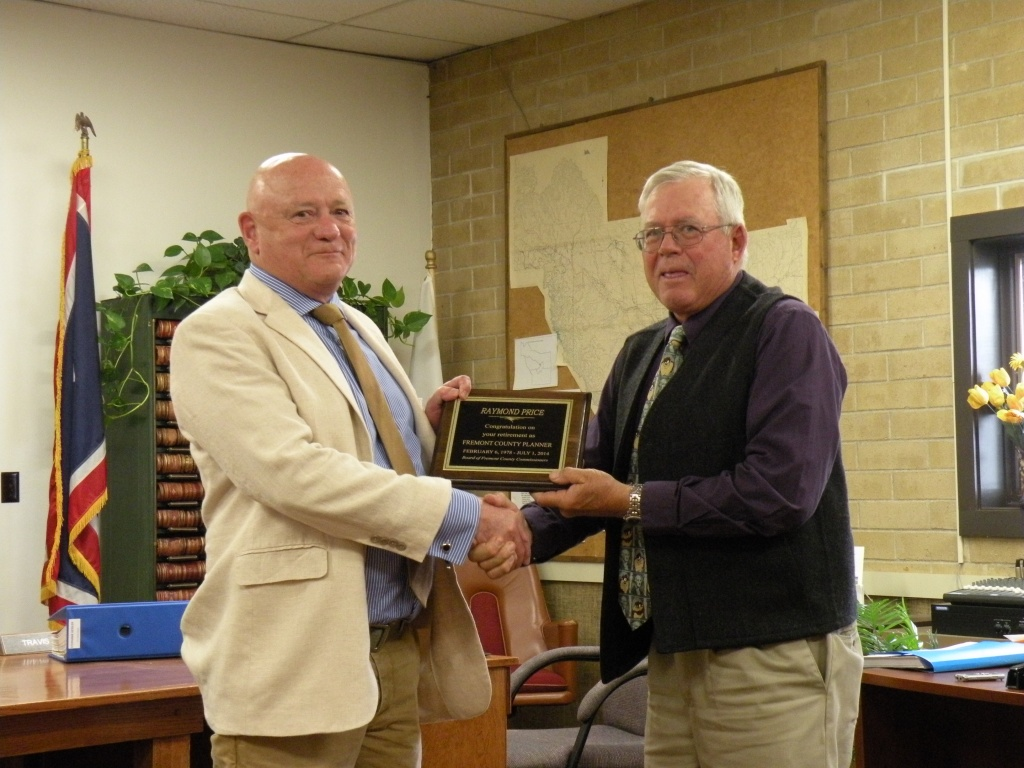 Fremont County Planner Ray Price accepts a plaque from County Commission Chairman Doug Thompson.