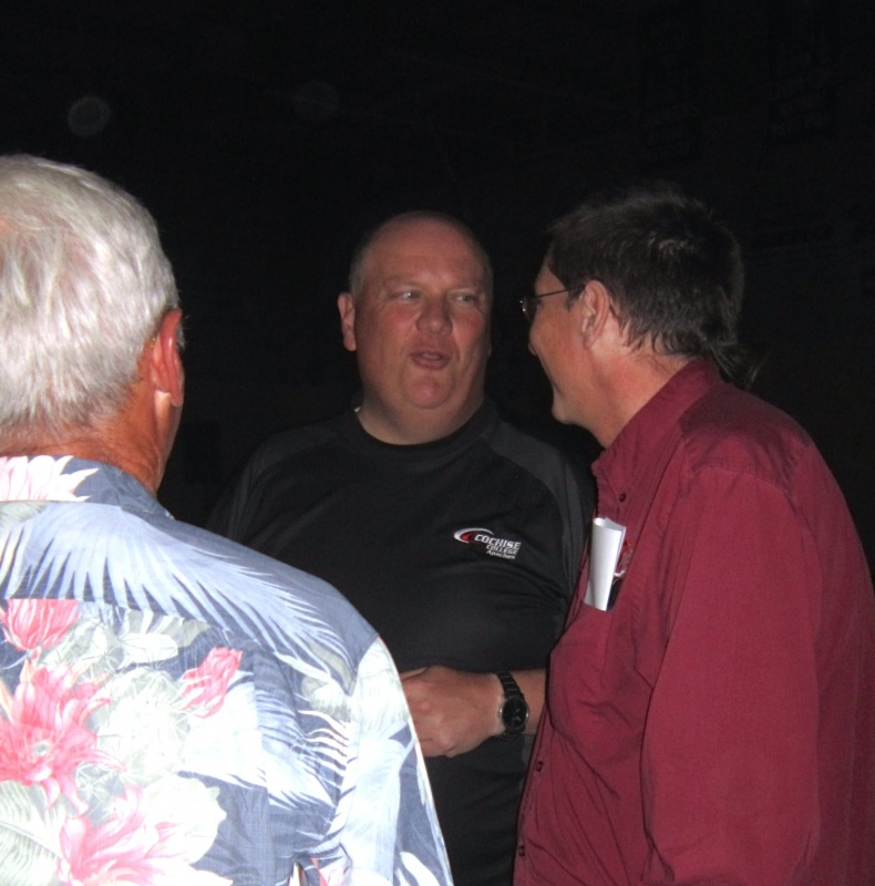 J.D. Rottweiler, Ph.D., CWC's former Executive Vice President and now President of Cochise College in Arizona, made the trip up north to attend the event.  Rottweiler, center, chatted with Dr. Roger Gose, left and John Woods. (Ernie Over photo)
