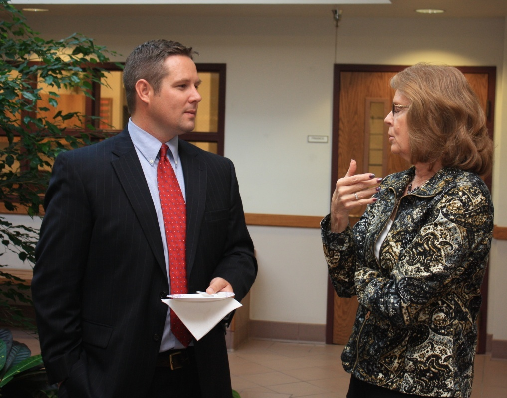 Kyle Butterfield visited with Community Development Director Sandy Luers during a meet-and-greet Tuesday night at City Hall. (Ernie Over photo)