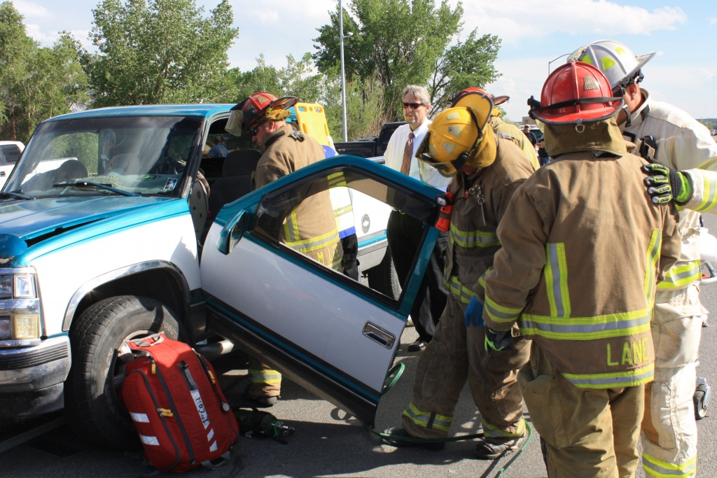Firefighters work to extricate the passenger from the vehicle that was struck in the intersection. (Ernie Over photo)