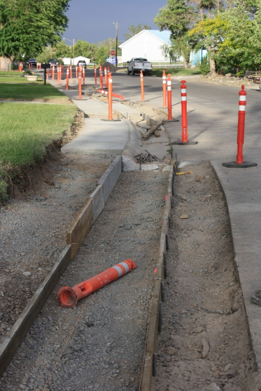 Optional one cent tax funds at work replacing curbs and gutters on East Pershing this week. Concrete work is also underway on South Federal and in the Woodridge Estates. (Ernie Over photo)