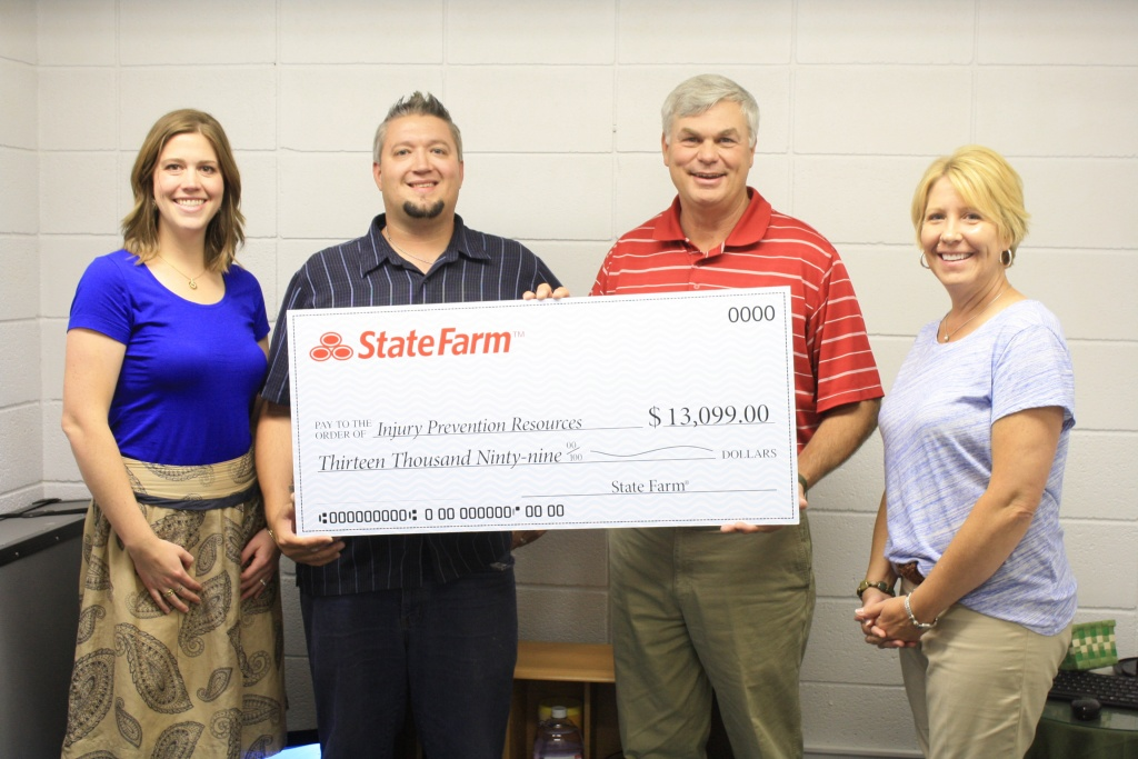 Injury Prevention Resources received a $13,099 check from State Farm Insurance to help fund its safety awareness campaigns and projects.  From left, Laurel LaBonde, State Farm; Noel Cooper, IPR; Agent Mike Yowell, State Farm; and Tamara Pachl, State Farm.  Not pictured, Agent Leslie Calkins.