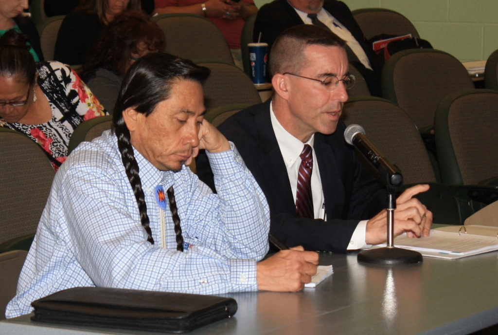 Northern Arapaho DFS Director James Trosper, left, listened to Wyoming DFS Director Steve Corsi during a portion of this morning's meeting dealing with child protective issues on the Wind River Reservation. (Ernie Over photo)