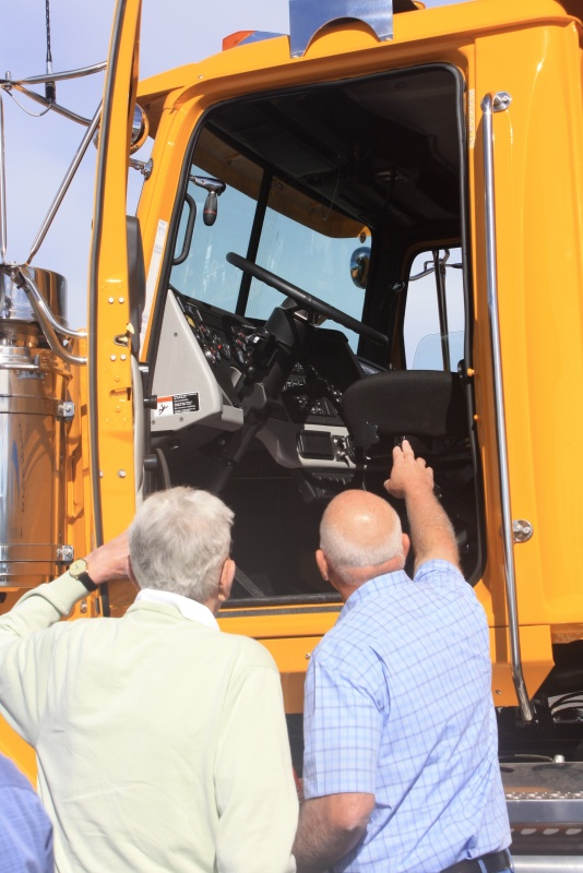 Airport Board member Jim Matson, left, and City Council member Richard Gard look at the new plow's cab interior Friday morning. (Ernie Over photo)