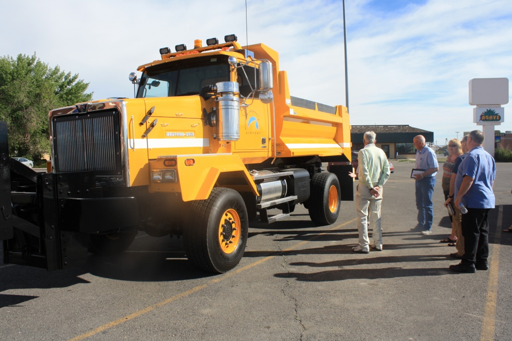 Members of the Airport Board and Airport  Manager Paul Griffin take a look at the new snowplow for Riverton Regional Airport Friday morning. (Ernie Over photo)
