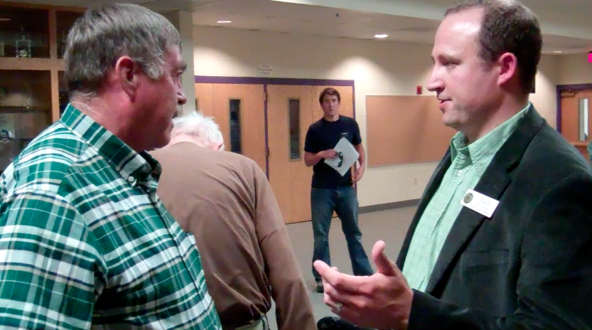 Jerimiah Rieman, right, has been named Gov. Mead's Natural Resources Policy Director. Here he spoke with east Pavillion resident  Jeff Locker in 2012.