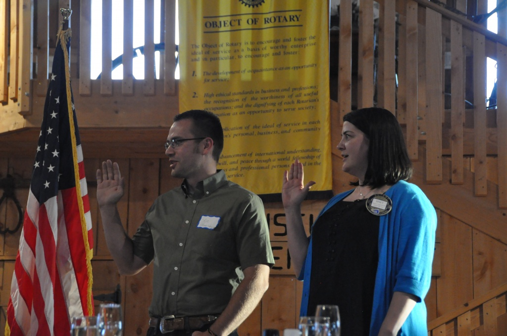 Skye Coleman-Weisz and Staci Lancaster take the oath as the new presidents of their respective Riverton and Lander Rotary Clubs. (Ken Richardson photo)