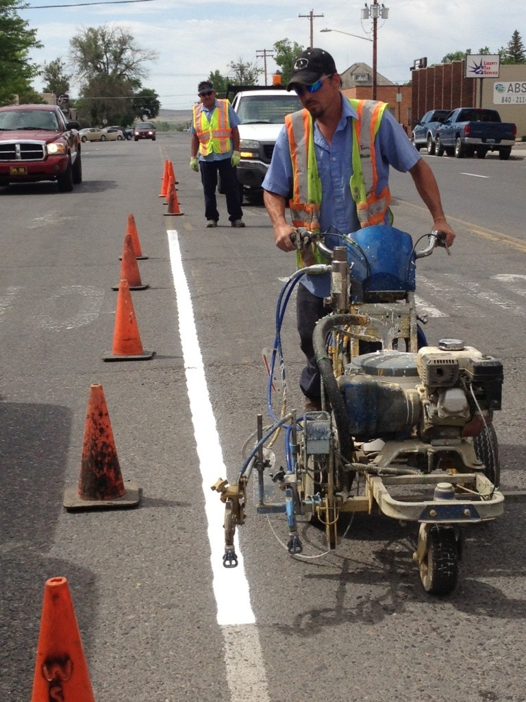 City of Riverton Streets employee Travis Lewis puts down fresh paint on traffic lanes on South Broadway Thursday morning. (Ernie Over photo)