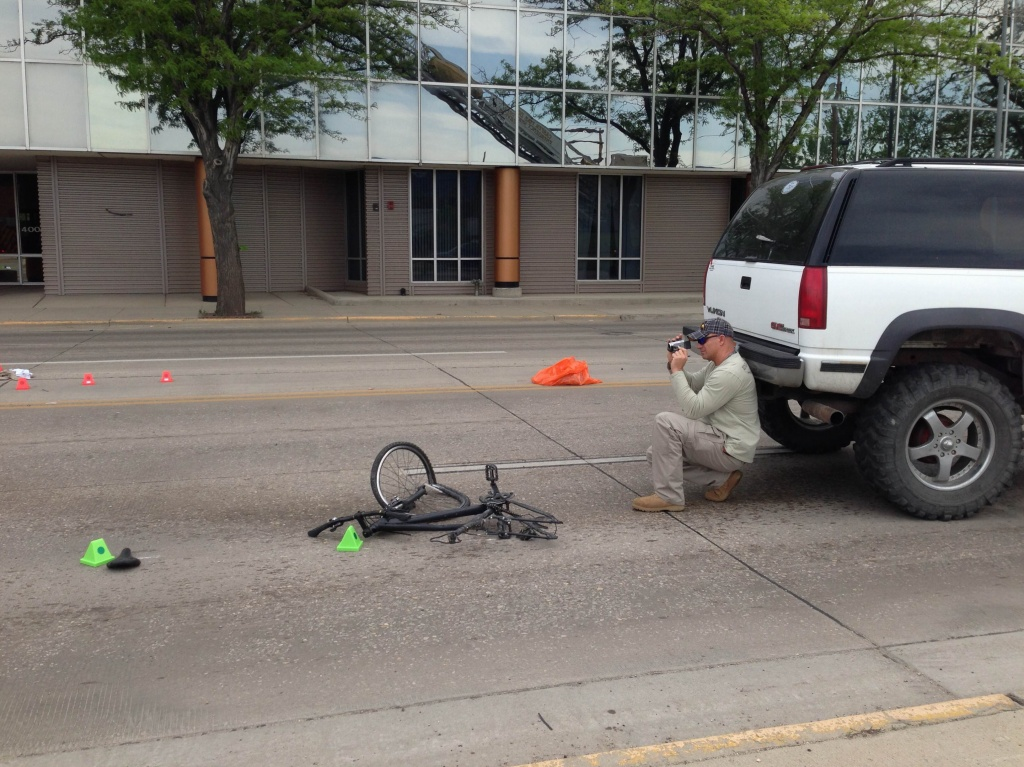 Casper Police Sgt. Richard Brown documenting the scene of last Thursday's fatal bicycle wreck.