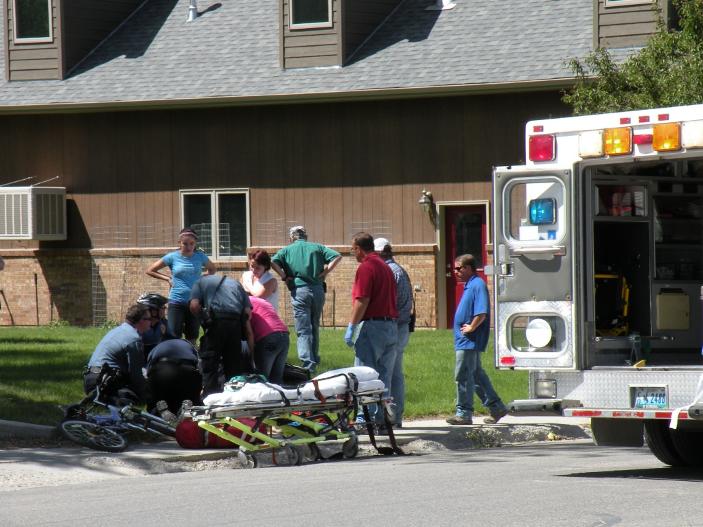 Emergency responders  treat the victim at the scene.