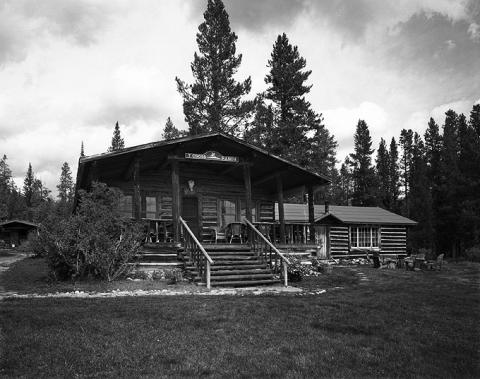 The porch and extended gable roof on the T Cross Ranch lodge are typical of the ranch's historic buildings. Wyoming SHPO photo.