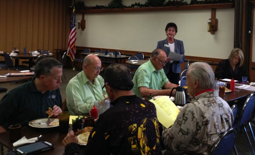 CWC President Jo Anne McFarland, standing, speaks at Wednesday morning's LEADER meeting at the Oxbow Restaurant.