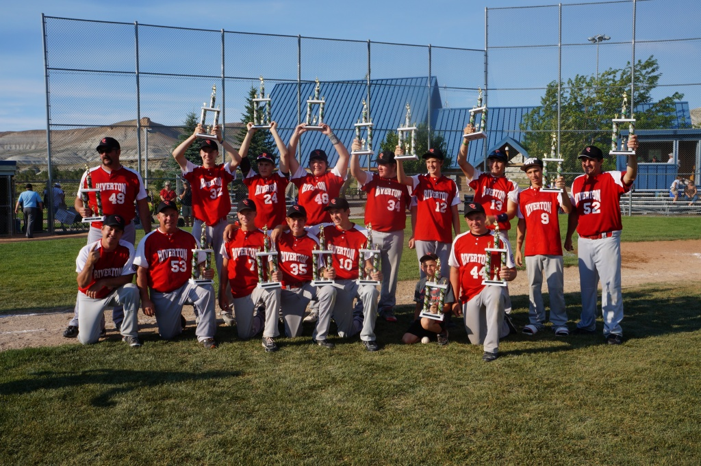 The 15-year-old State Babe Ruth Baseball Champions from Riverton hold their trophies high after winning the tournament in Green River this past weekend.