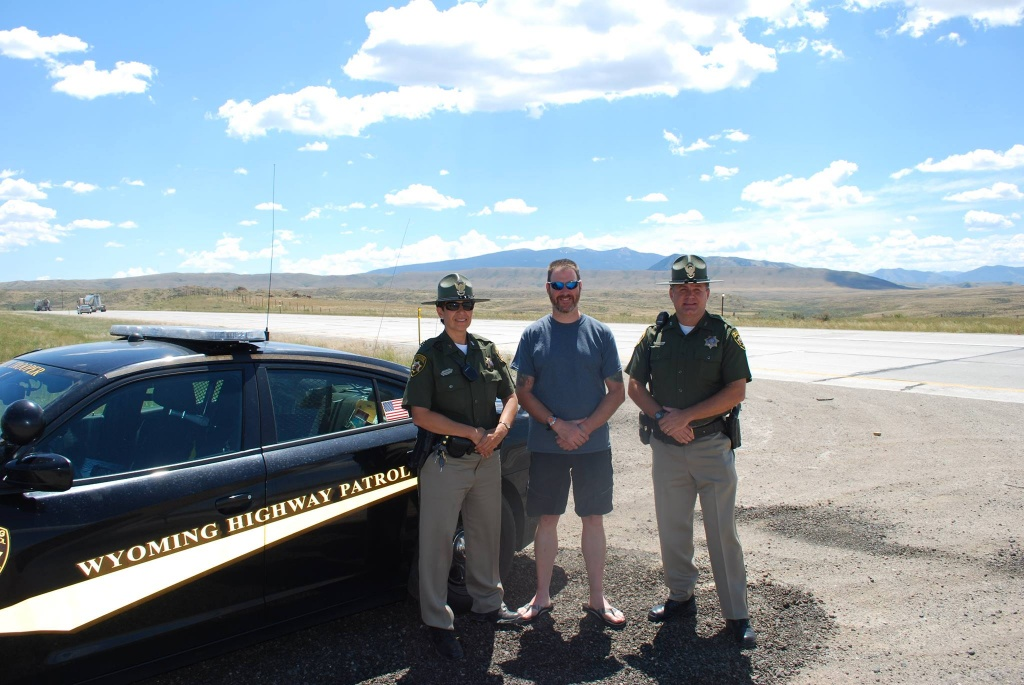 The shared picture is of Officer Harkins with Wyoming State Troopers near Elk Mountain, Wyoming.