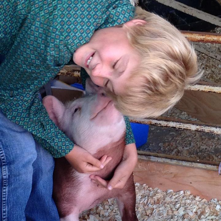 Keegan Thacker and his hog enjoy a hug at the Fremont County Fair on Wednesday. (Photo by Dawn Marie Connell Thacker)