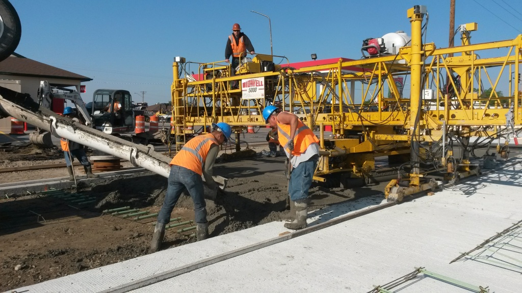 Pouring concrete at the East Monroe Intersection with South Federal Boulevard. (WYDOT)