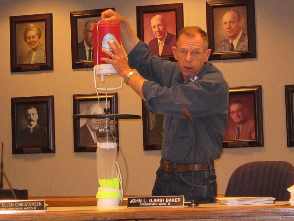 At a city council meeting one year ago, then councilor Lars Baker displayed the kind of mosquito trap being deployed around the county to monitor West Nile Virus Disease Vector mosquitos. (file photo)
