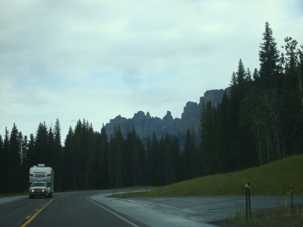 A pickup and camper drive the new Togwotee Pass highway near the Breccia Cliffs west of Dubois. (File Photo)