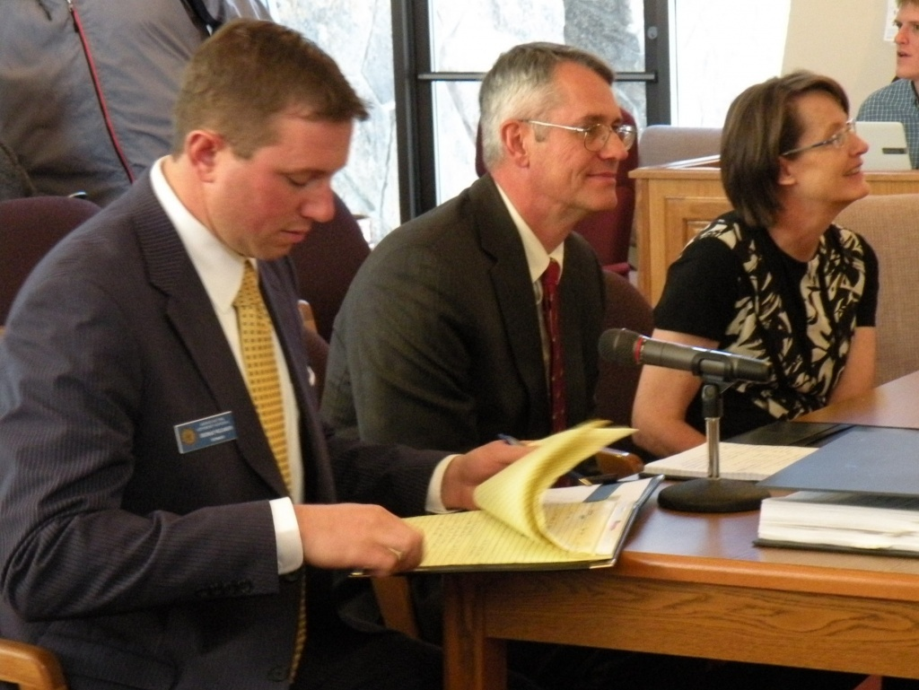 Wyoming Attorney General Peter K. Michael, center, at a meeting earlier this year.
