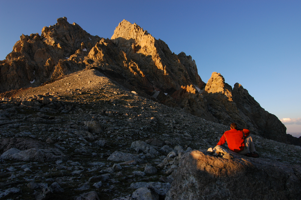 Climber in sunset on the lower saddle of the Grand Teton at elevation of 11,550'. Image by Geir Olav Lyngfjell/Shutterstock.com