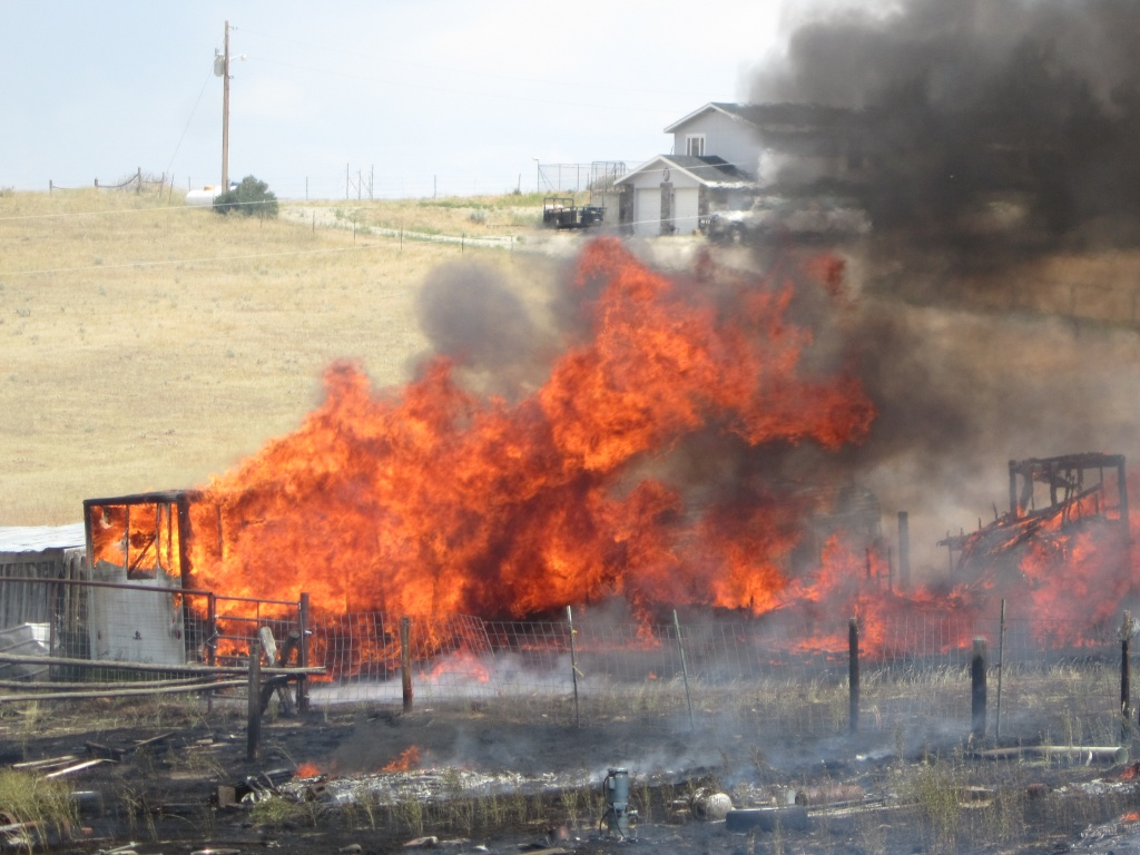A grass fire just south of Snavely Lane east of Lander spread into a barn housing a camper trailer, both were totally destroyed. (County10.com photo from July 2014)