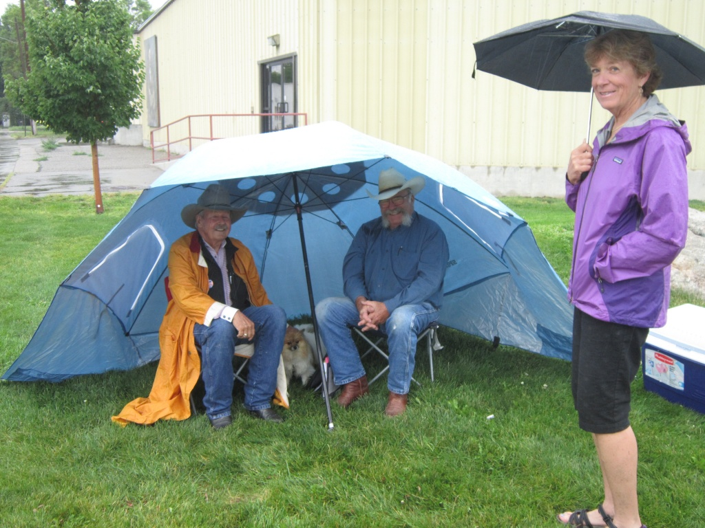 Doc Stockton and Jack Schmidt didn't let a little bit of rain dampen their spirits, as they entertained Pat Newlin with some Cowboy Poetry, even as the Music on the Riverwalk was cancelled Friday night. (Ernie Over photo)