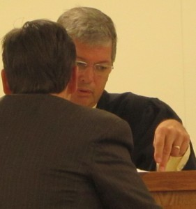 Judge Roberts conferred with prosecutor Bennett over an non-redacted affidavit presented to support the charges against Brock. (Ernie Over photo)