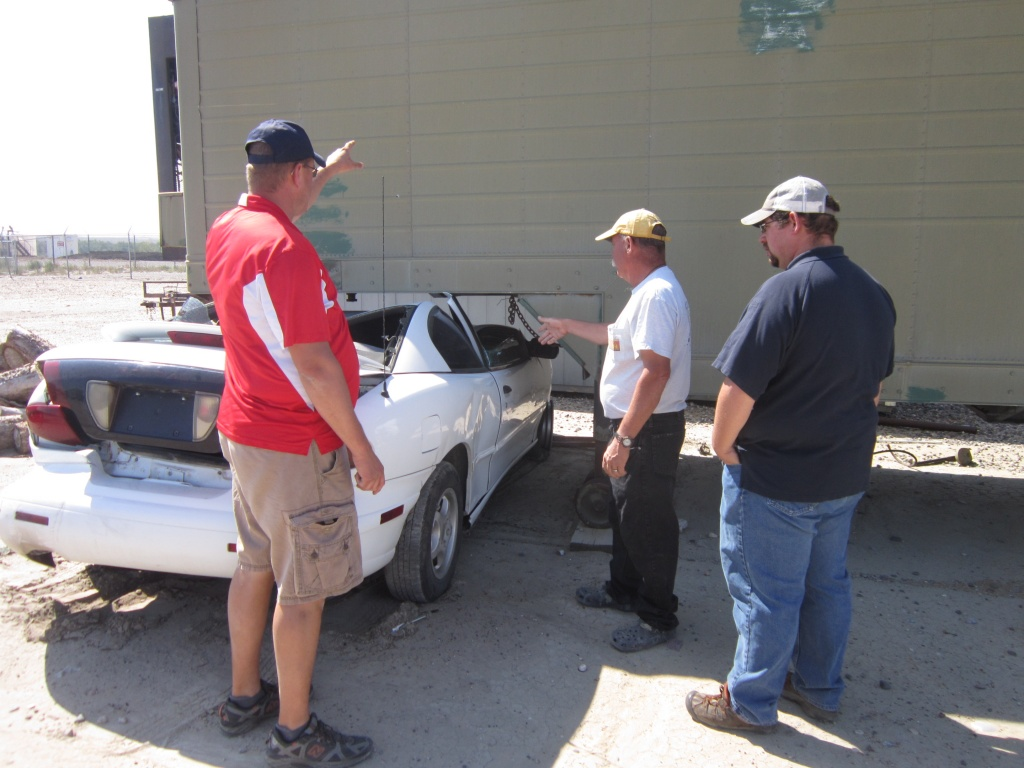 RFD's Scott Walters, WFA's Ken Metzler and LFD's Eric Siwik discussed potential extrication scenarios for a vehicle that crashed into a refrigerated trailer. (Ernie Over photo)